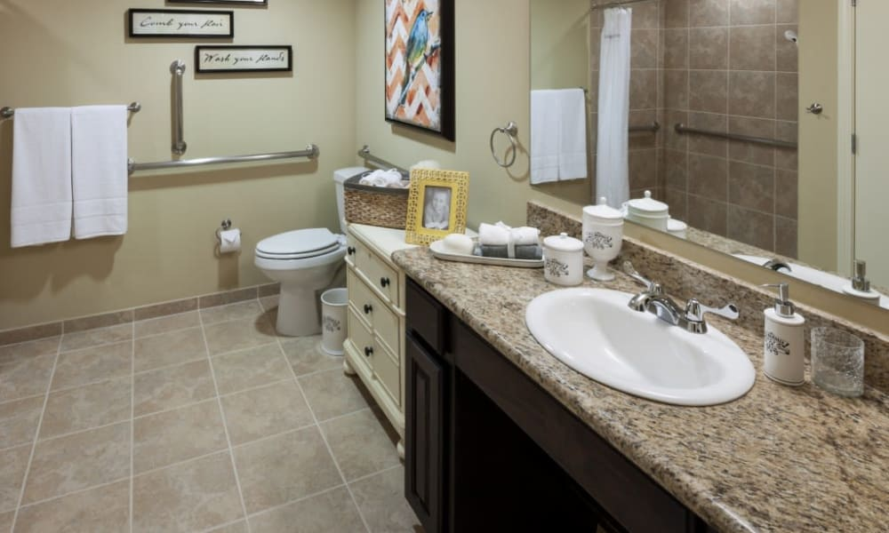 A decorated apartment bathroom at Anthology of Stonebridge Ranch in McKinney, Texas