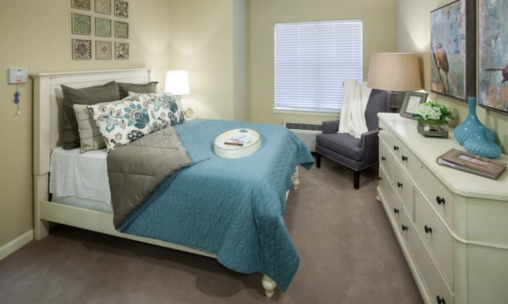 A model apartment bedroom at Anthology of Stonebridge Ranch in McKinney, Texas