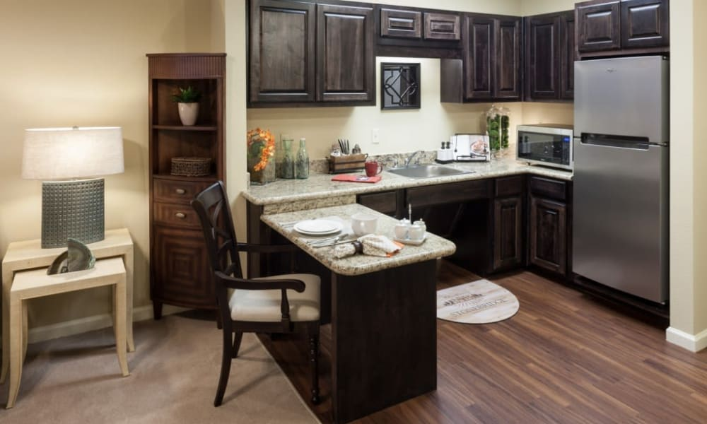 An upgraded model kitchen at Anthology of Stonebridge Ranch in McKinney, Texas