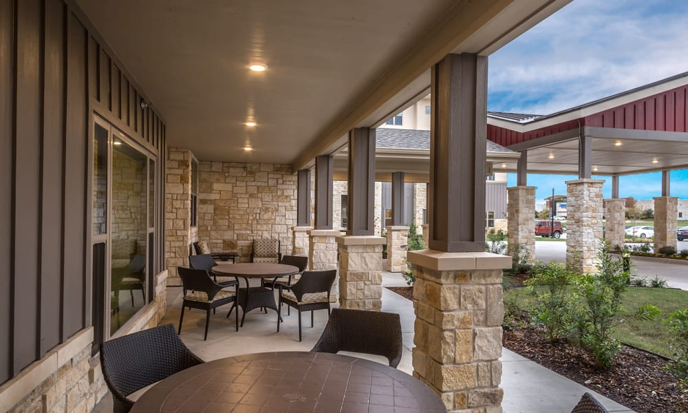 Covered outdoor seating for residents at Anthology of Plano in Plano, Texas