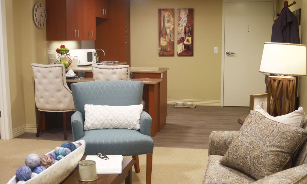 An apartment living room and kitchen at Anthology of Olathe in Olathe, Kansas