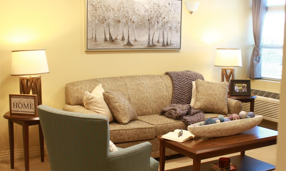 Comfortable couches in an apartment living room at Anthology of Olathe in Olathe, Kansas