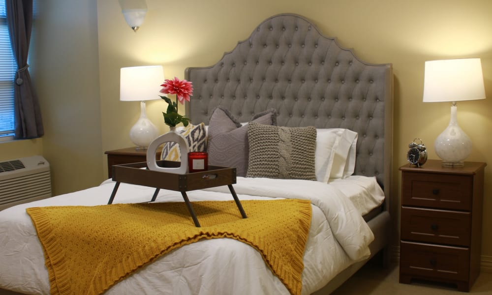 A well made bed at Anthology of Olathe in Olathe, Kansas