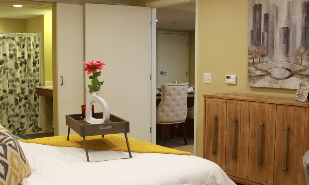 An apartment bedroom with an attached bathroom at Anthology of Olathe in Olathe, Kansas