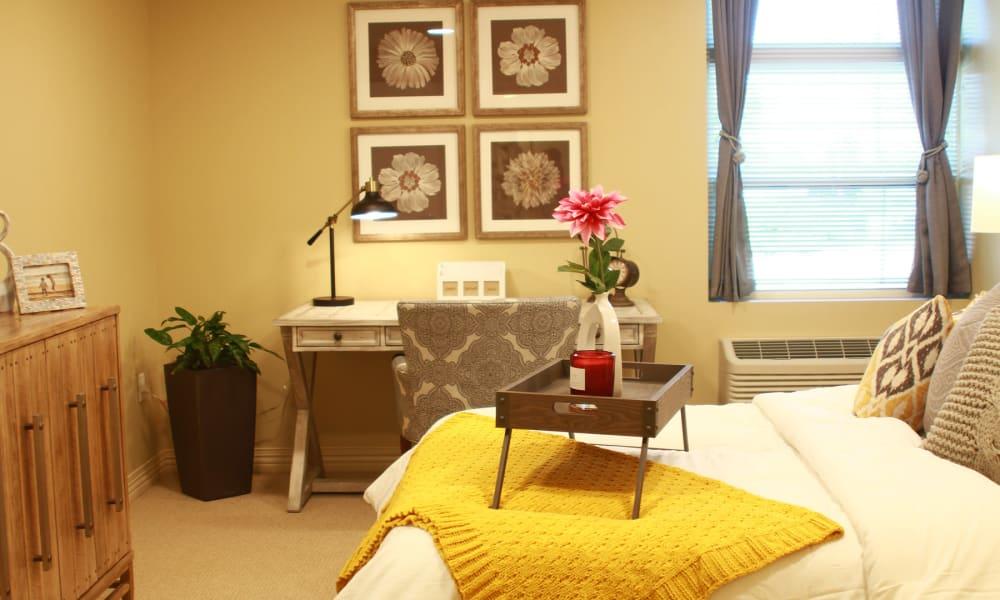 A furnished apartment bedroom at Anthology of Olathe in Olathe, Kansas