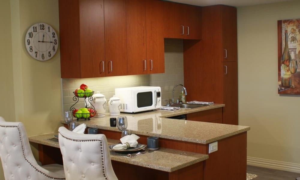A kitchen in a model apartment at Anthology of Olathe in Olathe, Kansas