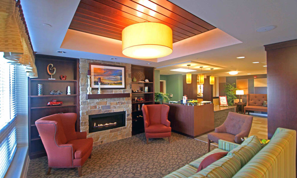 A lounge with fireside seating at Anthology of Grayslake in Grayslake, Illinois