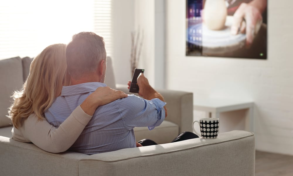 Couple watching TV at The Nathaniel in Rochester, New York