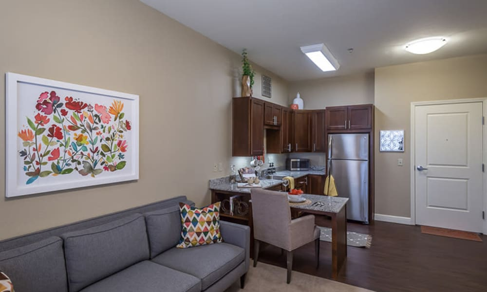 Resident living room and kitchenette at Anthology of Plano in Plano, Texas.