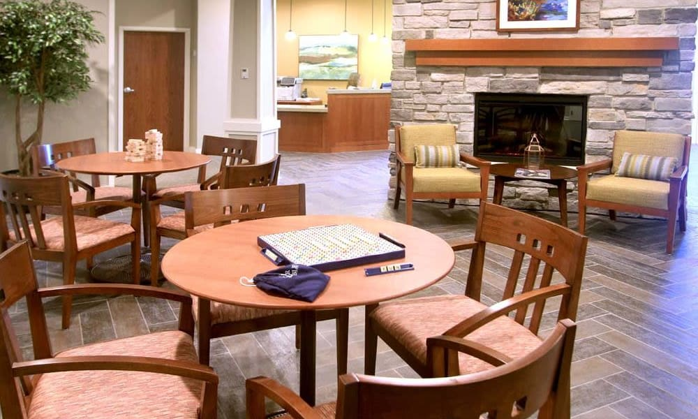 Community room with a fireplace at Anthology of Wheaton in Wheaton, Illinois.