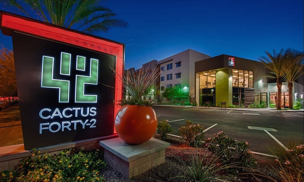 Our sign lit up at night welcoming residents back home to Cactus Forty-2 in Phoenix, Arizona