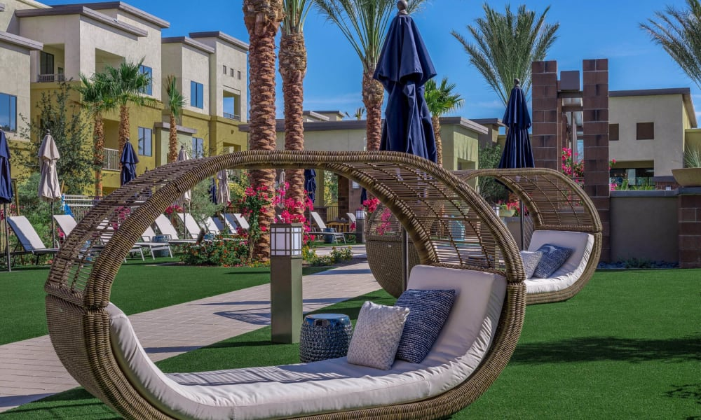 Wicker lounge chairs near the barbecue area at Cadia Crossing in Gilbert, Arizona
