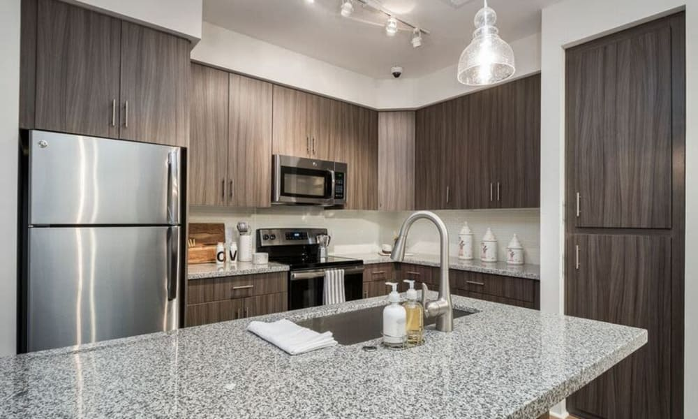Stainless-steel appliances in the modern kitchen of a model home at Cadia Crossing in Gilbert, Arizona