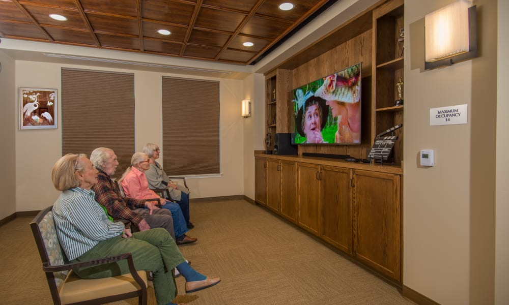 4 residents sitting and watching tv at Quail Park Memory Care Residences of West Seattle in Seattle, Washington