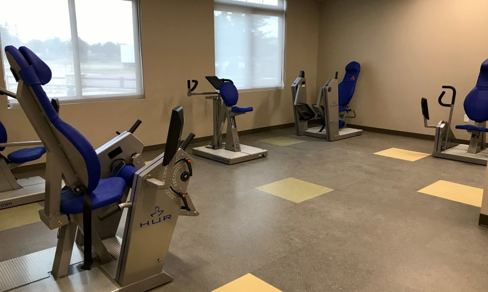 Fitness room with varied equipment at Quail Park at Shannon Ranch in Visalia, California