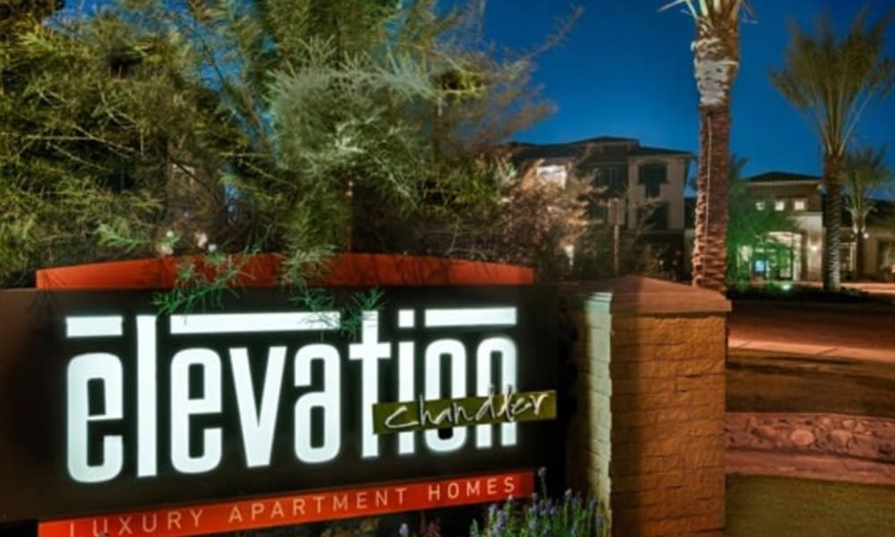 Our community sign welcoming residents back home in the evening to Elevation Chandler in Chandler, Arizona
