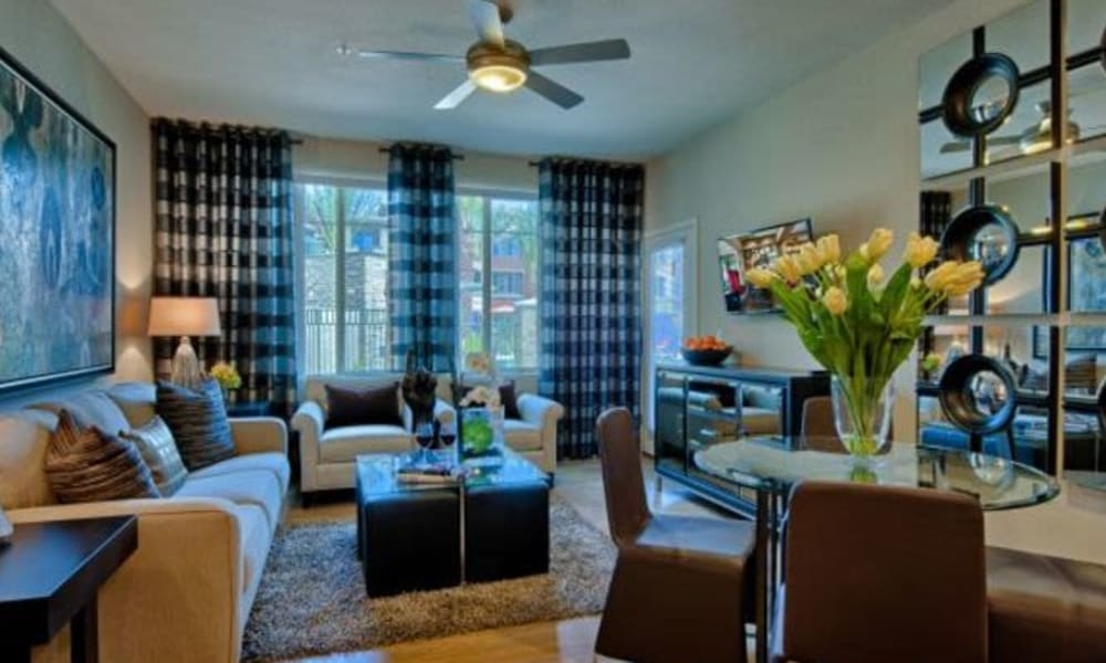 Ceiling fan and modern decor in the living area of a model home at Elevation Chandler in Chandler, Arizona