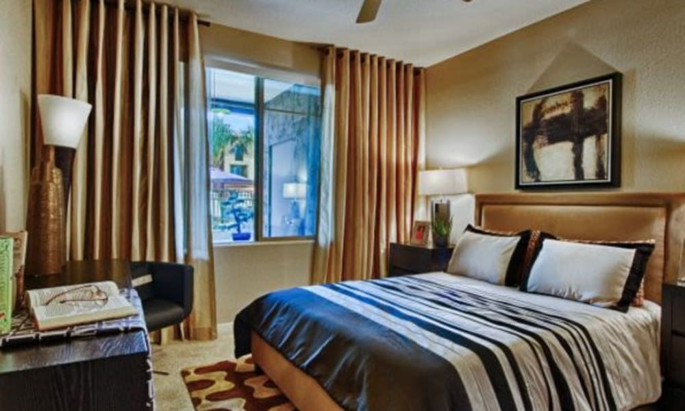 Luxuriously furnished model home's master bedroom at Elevation Chandler in Chandler, Arizona