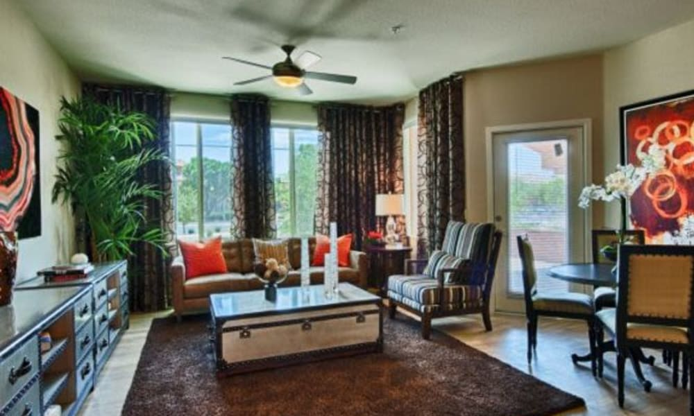 Hardwood flooring and a ceiling fan in a model apartment's living space at Elevation Chandler in Chandler, Arizona