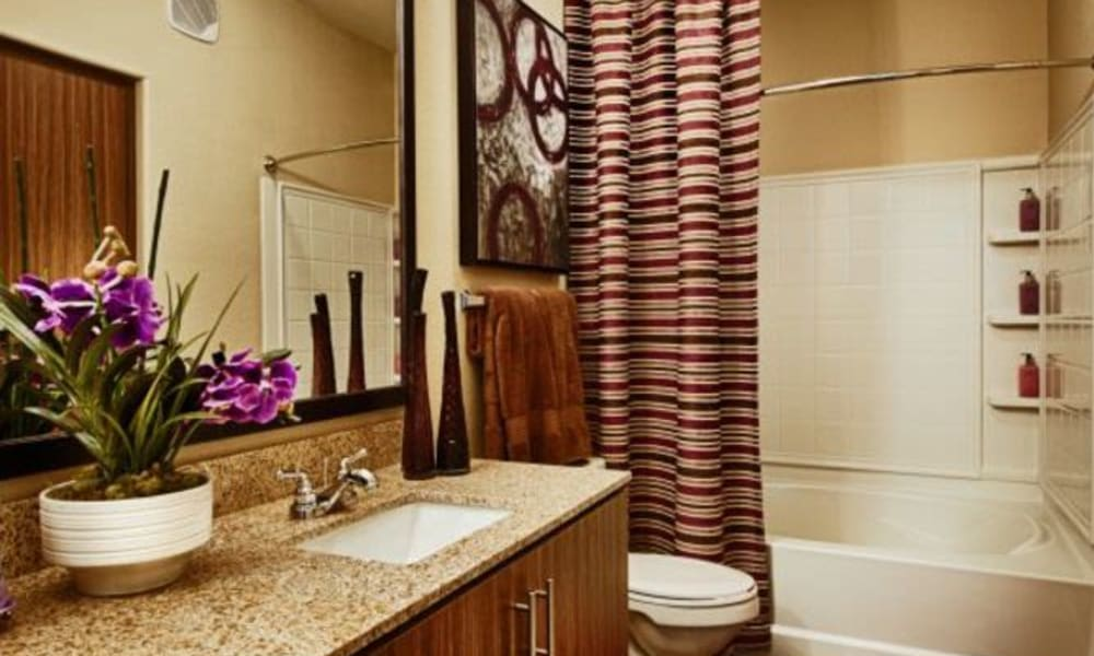 Granite countertop in a model home's bathroom at Elevation Chandler in Chandler, Arizona