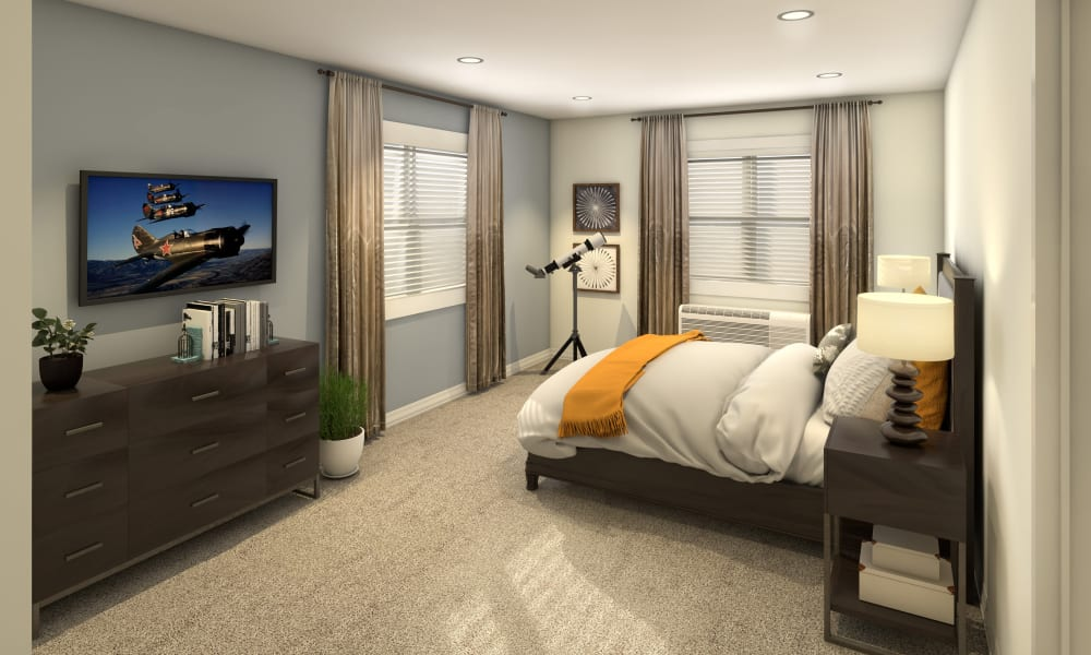 Resident bedroom with large windows and natural light at Anthology of Olathe in Olathe, Kansas.