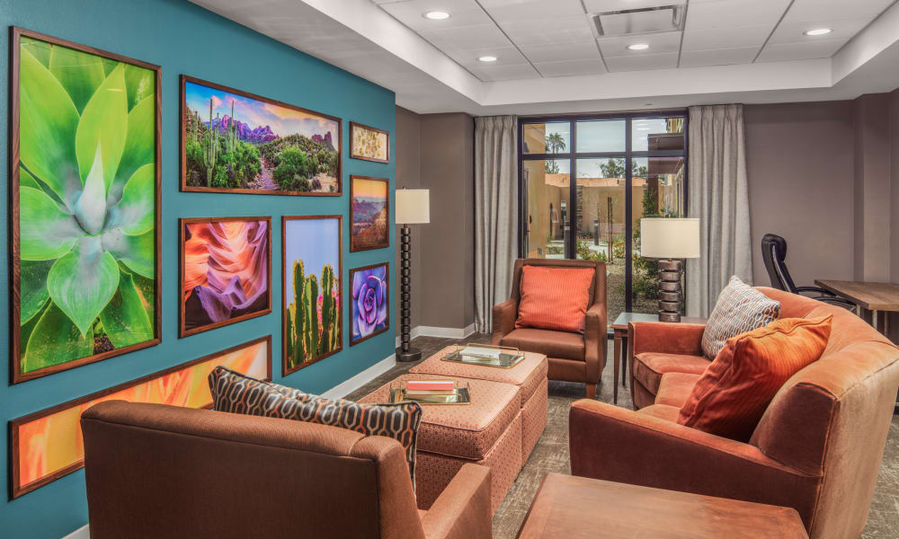 Memory care lounge with floral imagery on the wall at Quail Park of Oro Valley in Oro Valley, Arizona