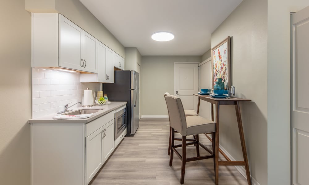 Senior apartment kitchen at Quail Park of Oro Valley in Oro Valley, Arizona
