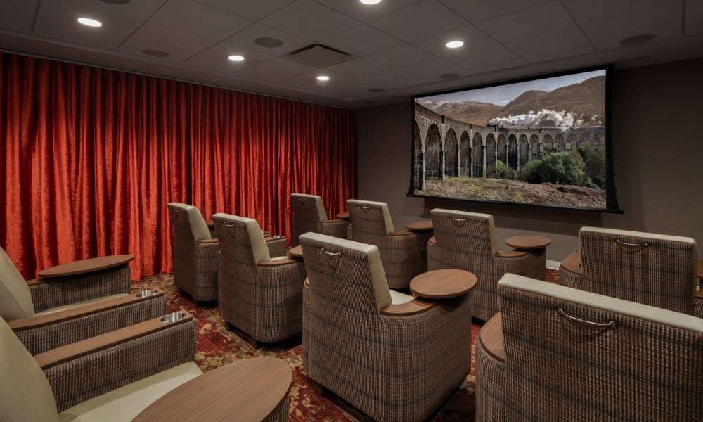 In house movie theater at Quail Park of Oro Valley in Oro Valley, Arizona