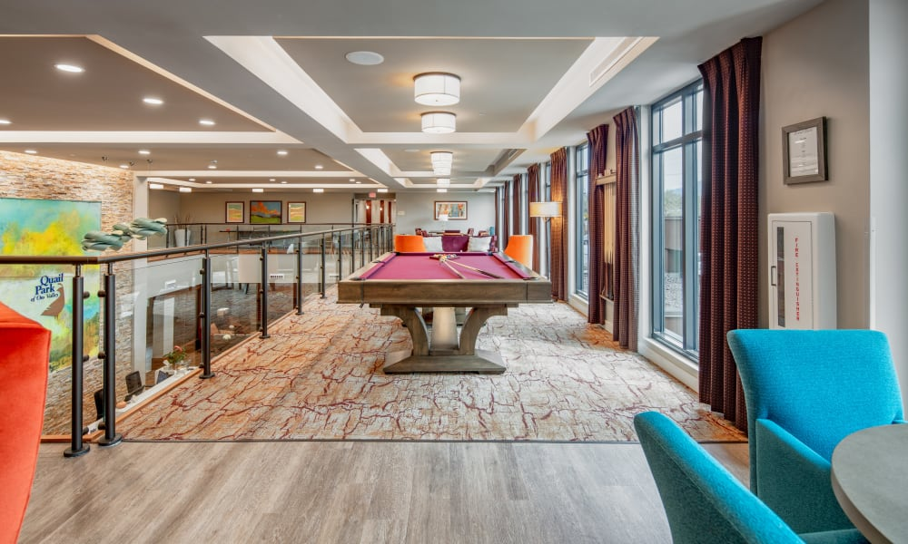 2nd floor activity lounge with a pool table at Quail Park of Oro Valley in Oro Valley, Arizona