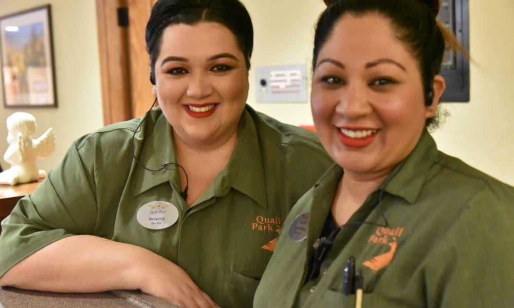 2 Caretakers smiling at the camera at Quail Park Memory Care Residences of Visalia in Visalia, California