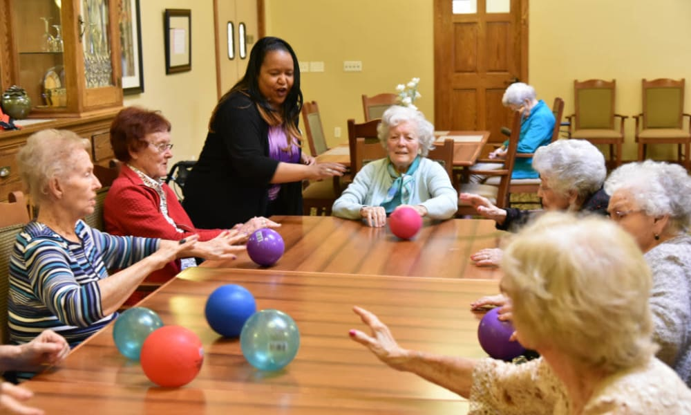 Residents playing a memory game at Quail Park Memory Care Residences of Visalia in Visalia, California