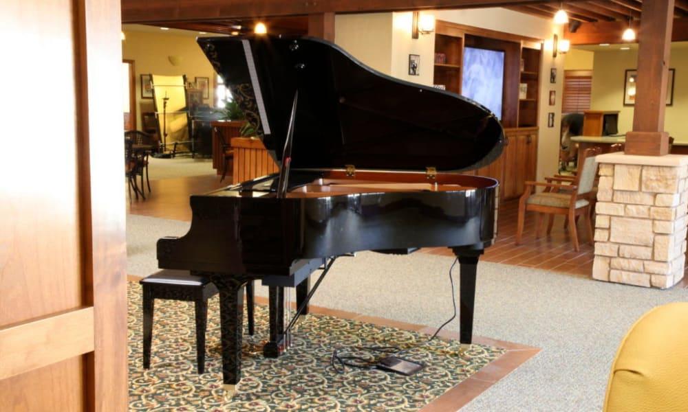 Piano in a lounge at Quail Park Memory Care Residences of Visalia in Visalia, California