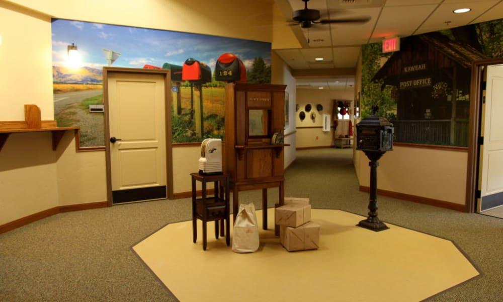 Trading post themed hallway at Quail Park Memory Care Residences of Visalia in Visalia, California