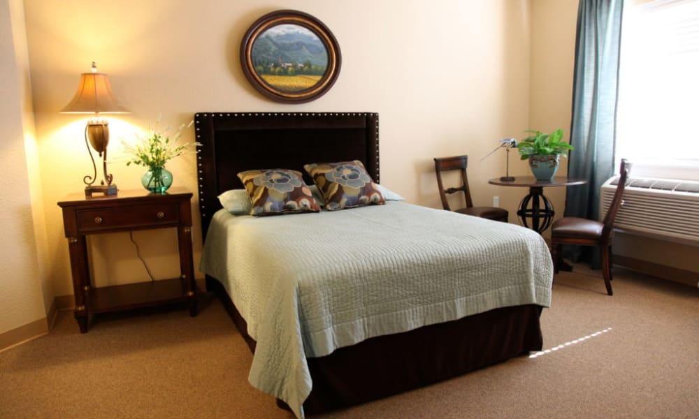 Bedroom in a senior apartment at Quail Park Memory Care Residences of Visalia in Visalia, California