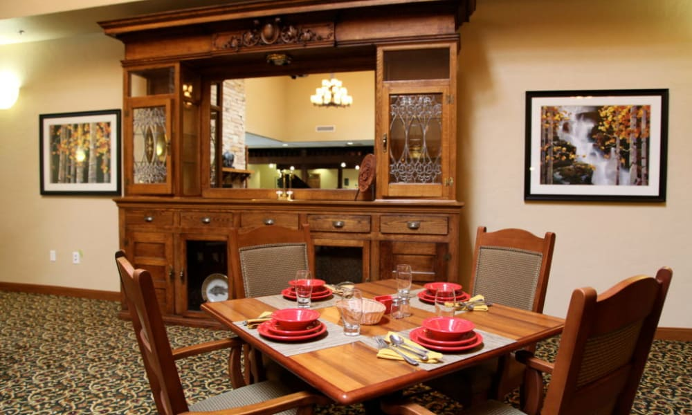 Square dining table set for four at Quail Park Memory Care Residences of Visalia in Visalia, California