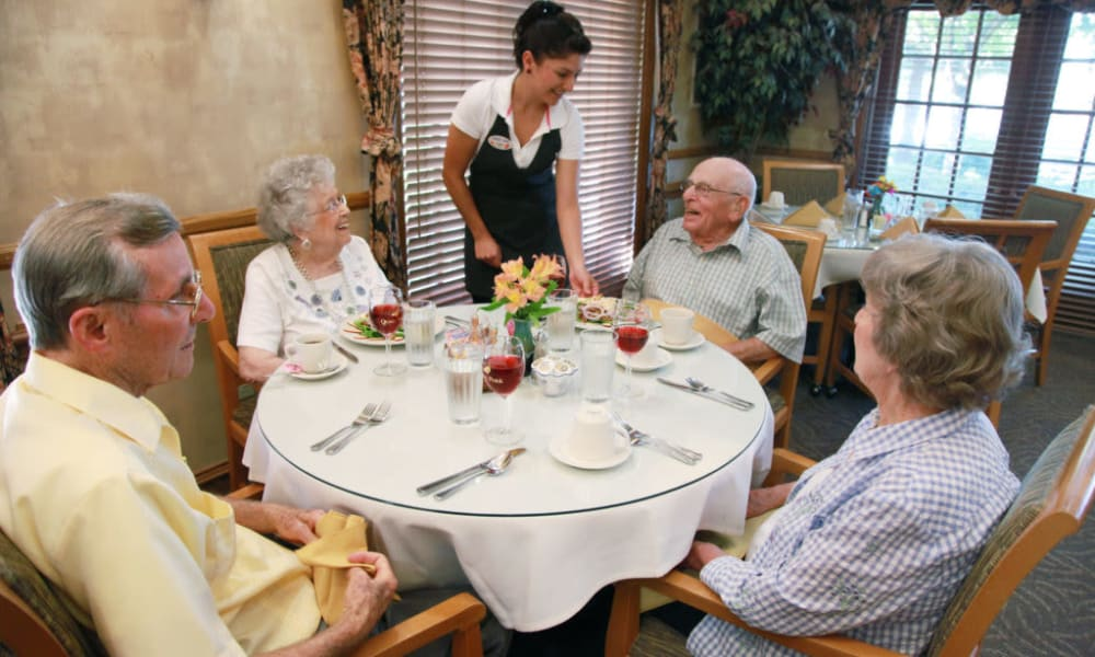 Residents in the dining hall having their order taken at Quail Park on Cypress in Visalia, California