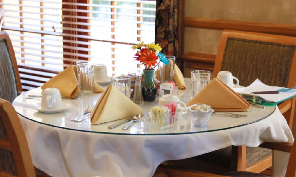 Dining table set for four at Quail Park on Cypress in Visalia, California