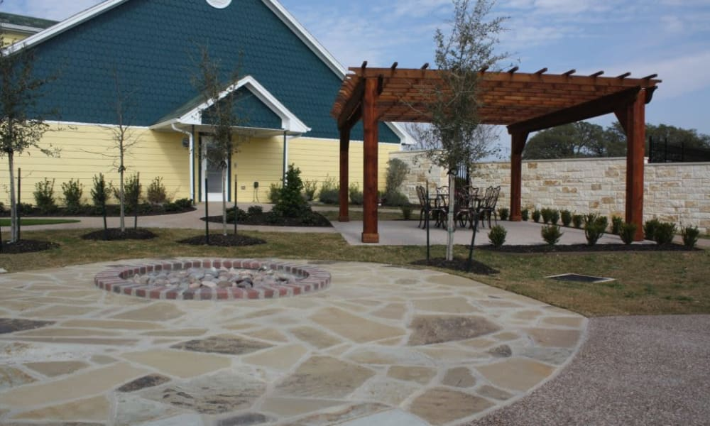 Fire pit built into the patio at Quail Park of Granbury in Granbury, Texas