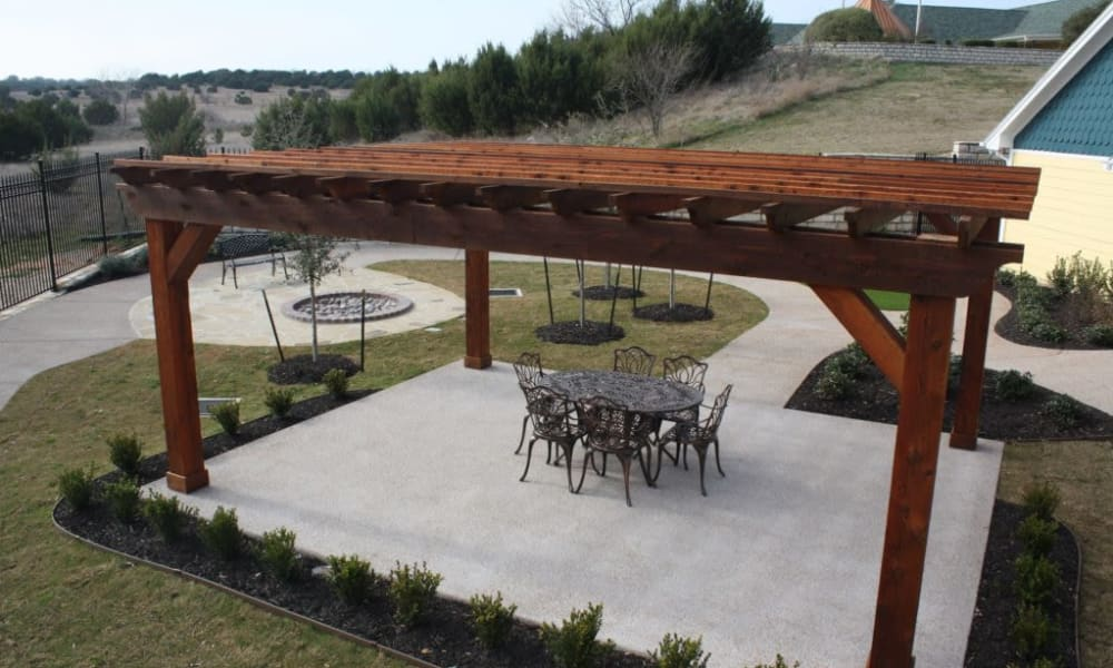 Covered patio outside of Quail Park of Granbury in Granbury, Texas
