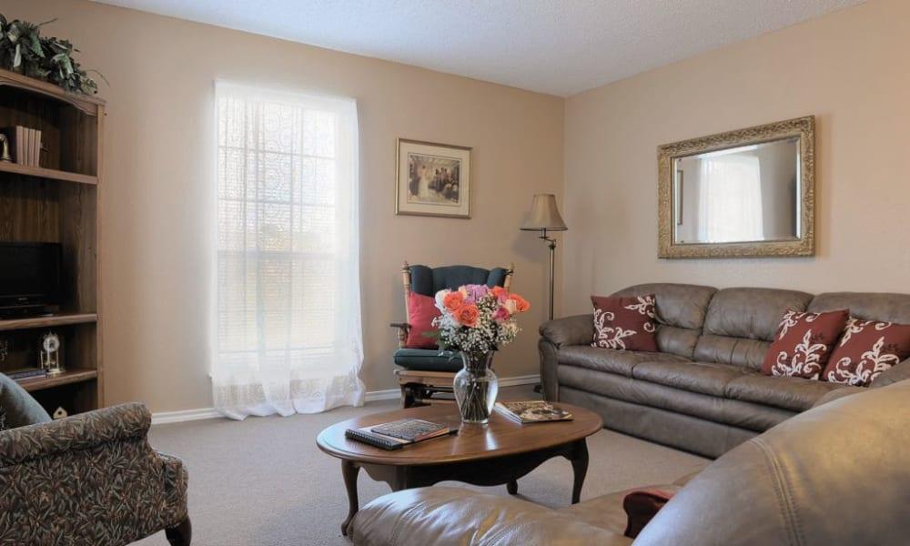 Apartment living room at Quail Park of Granbury in Granbury, Texas