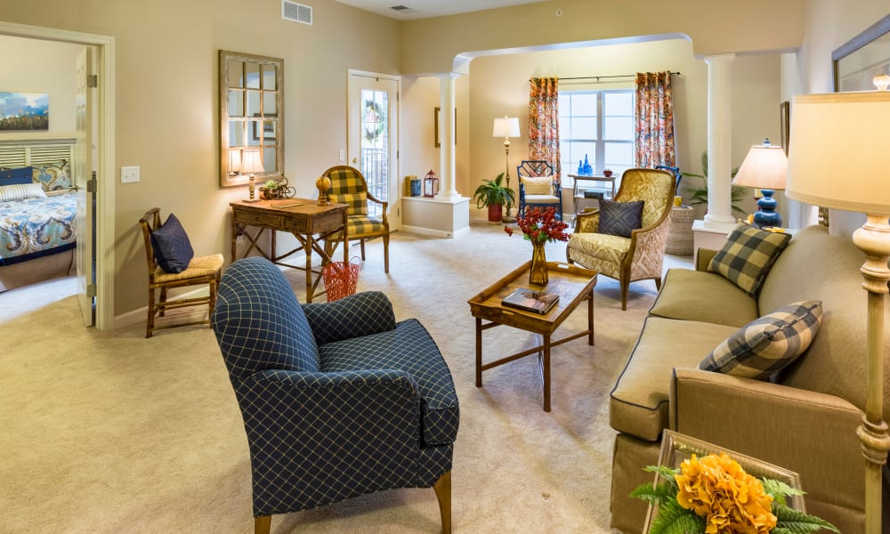 An apartment living room and bedroom at Keystone Place at Richland Creek in O'Fallon, Illinois