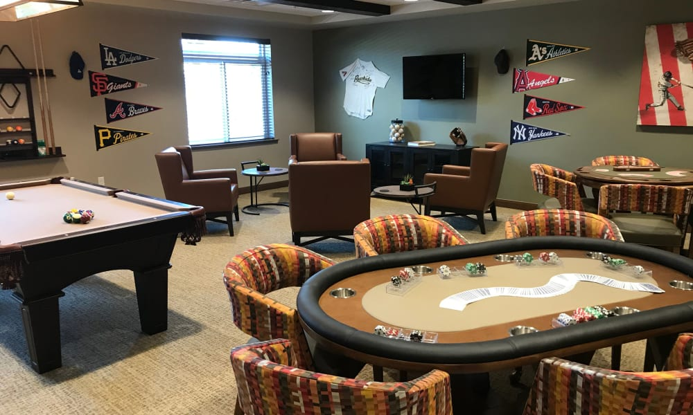 Game room with betting tables and billiards at Quail Park at Shannon Ranch in Visalia, California