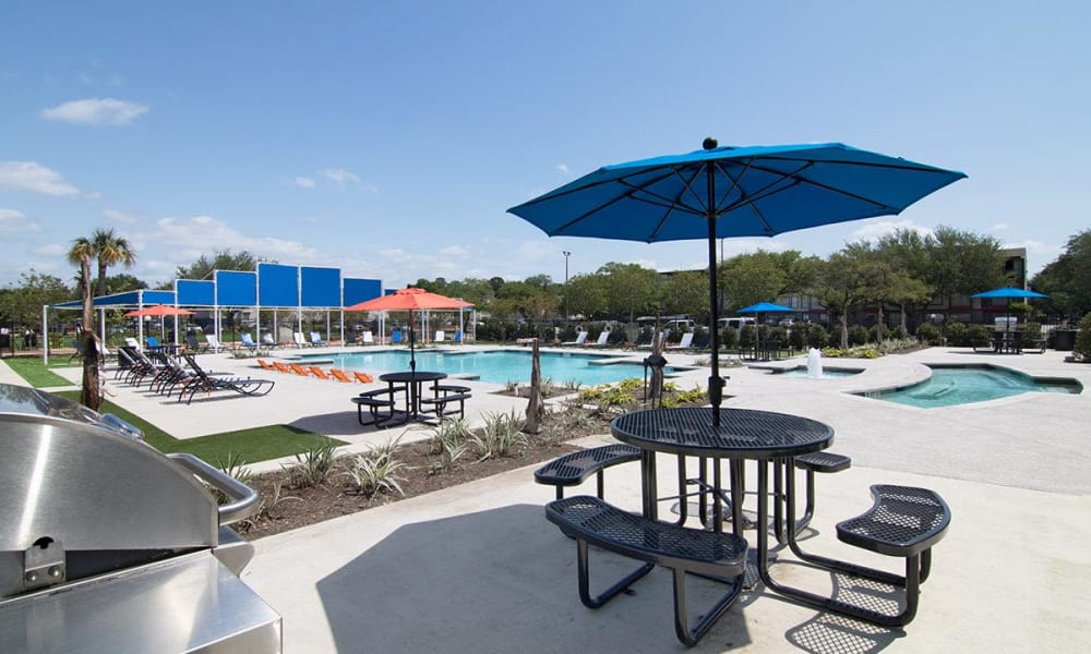 Covered poolside seating at 2111 Holly Hall in Houston, Texas