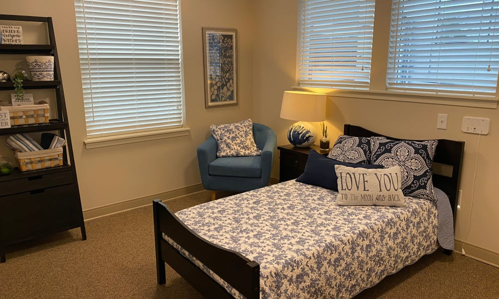 Senior apartment bedroom at Quail Park Memory Care Residences of West Seattle in Seattle, Washington