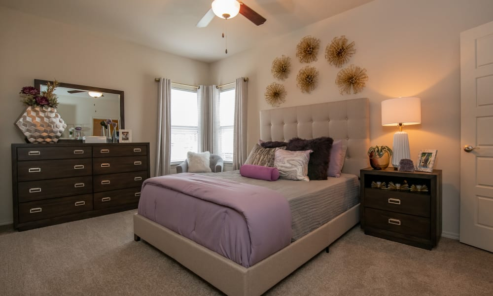 Primary bedroom with a ceiling fan at Cedar Ridge in Tulsa, Oklahoma