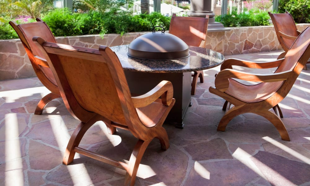 Fire pit area with comfortable chairs at El Potrero Apartments in Bakersfield, California