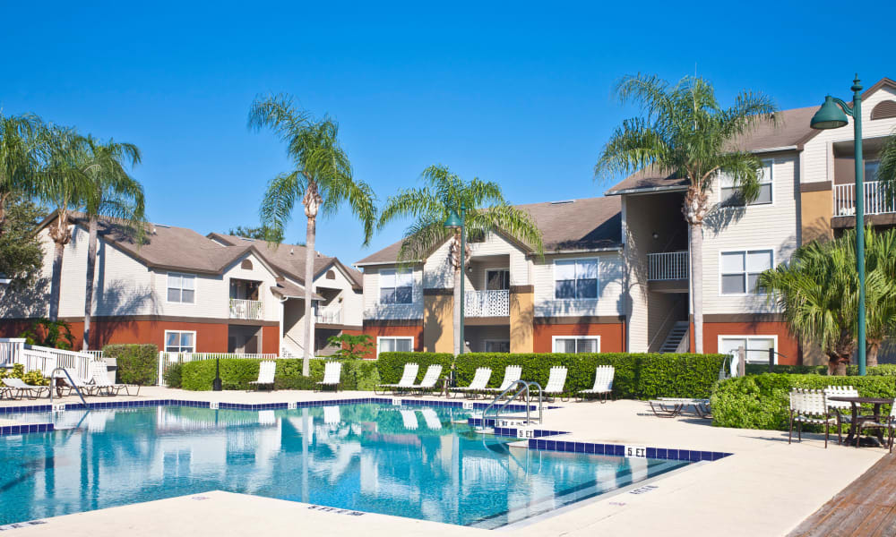 Swimming pool area on a beautiful day at El Potrero Apartments in Bakersfield, California