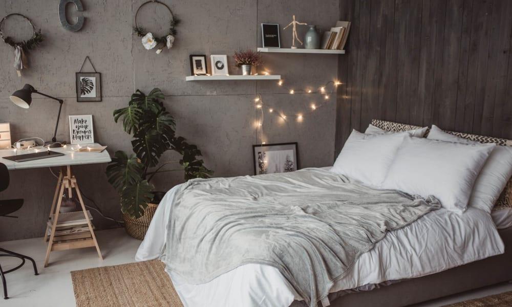 Comfortable decor in a model apartment's master bedroom at El Potrero Apartments in Bakersfield, California