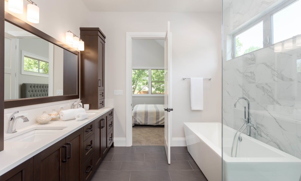 Ample countertop space in the en suite master bathroom of a model home at Highland View Court in Bakersfield, California