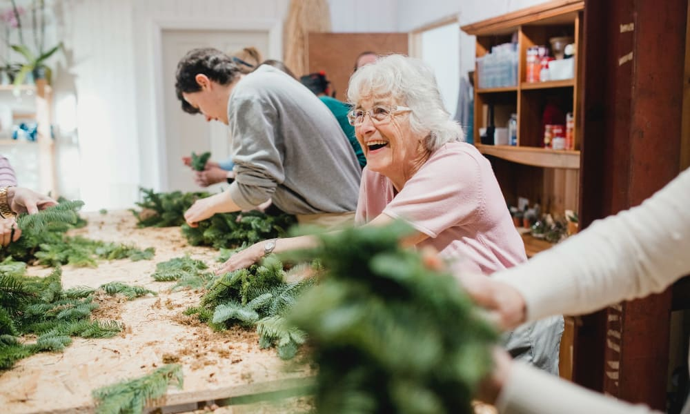 Residents making wreaths at White Oaks in Lawton, Michigan